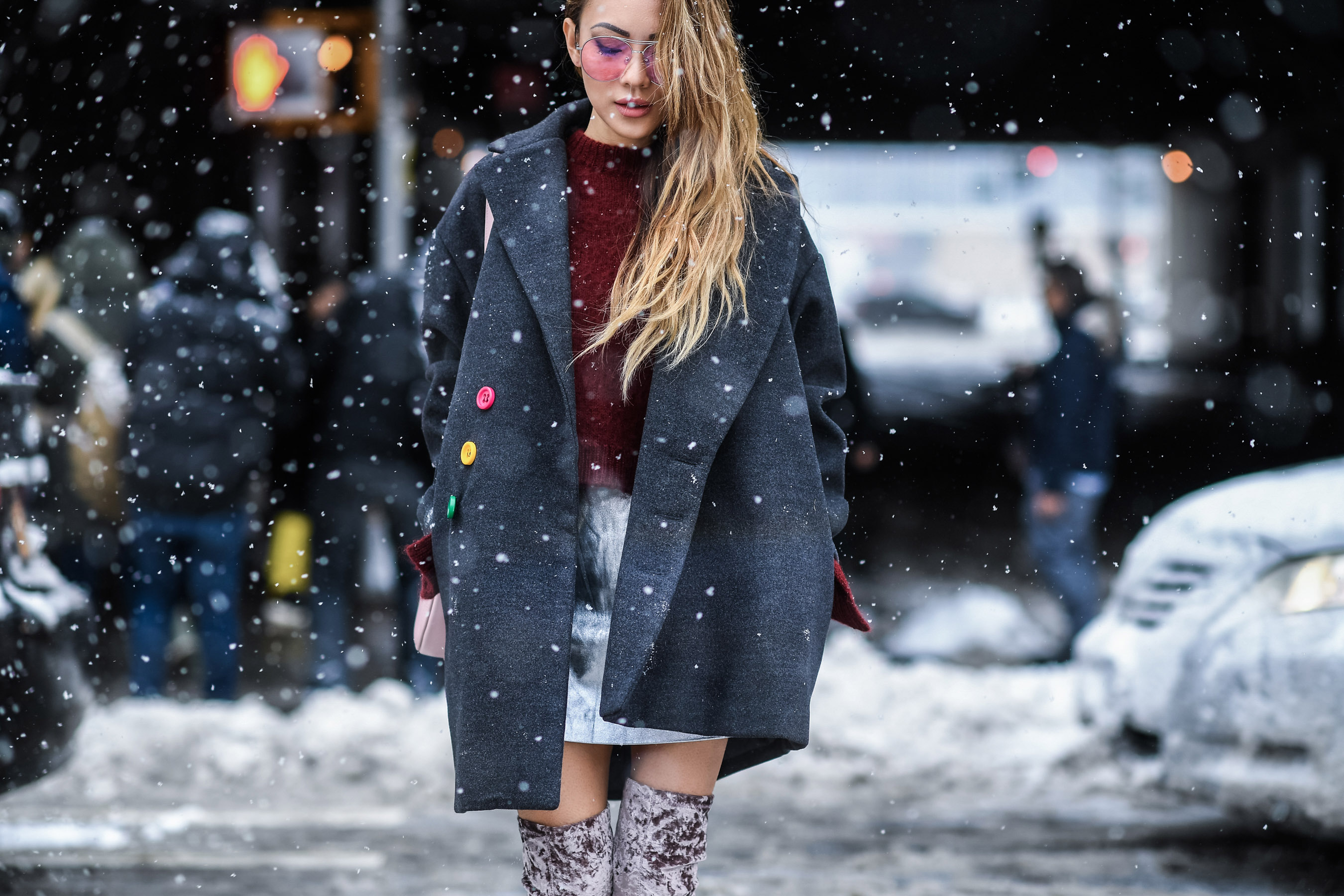 Places for Great Snow Photos in NYC // NotJessFashion.com // Over the knee velvet boots, silver mini skirt, oversized menswear inspired coat, burgundy knit sweater, jessica wang