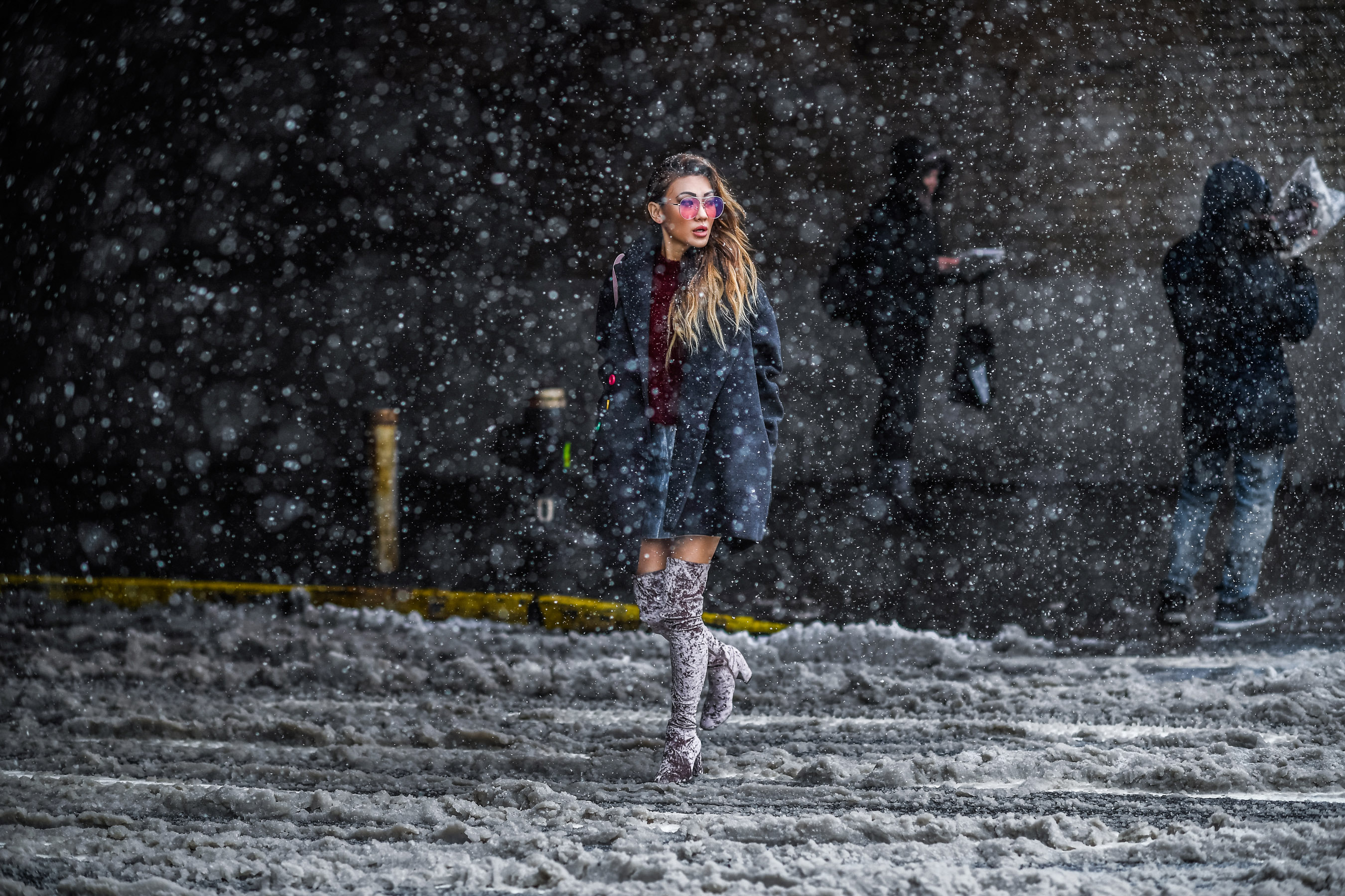 Places for Great Snow Photos in NYC // NotJessFashion.com // Over the knee velvet boots, silver mini skirt, oversized menswear inspired coat, pink aviator sunglasses, jessica wang