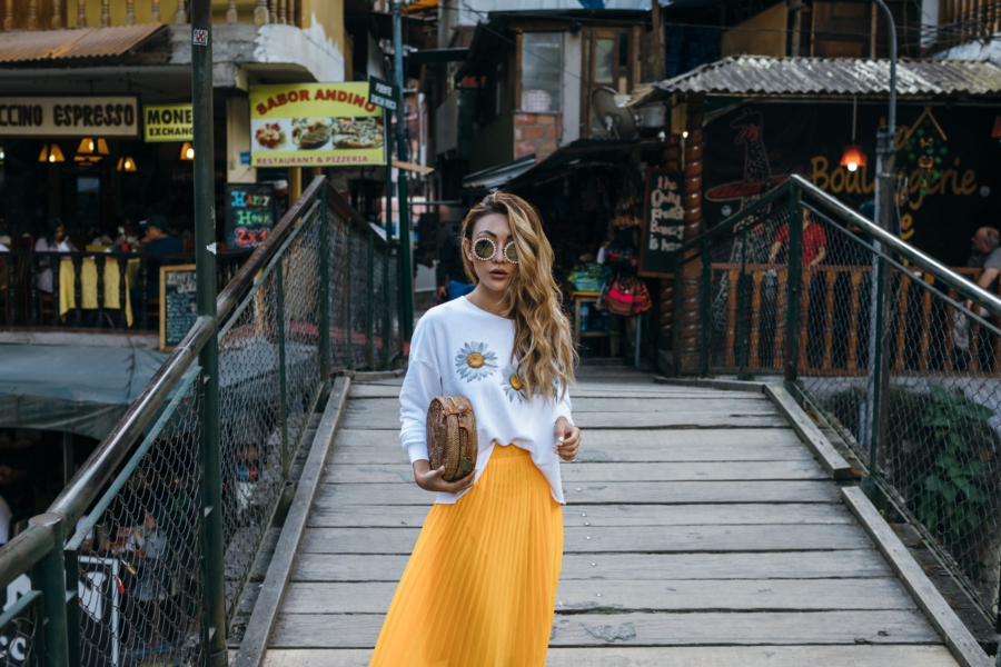 Exploring Aguas Calientes in Yellow Pleated Skirt - New Sunglasses Shapes That Are Fun and Luxe // NotJessFashion.com