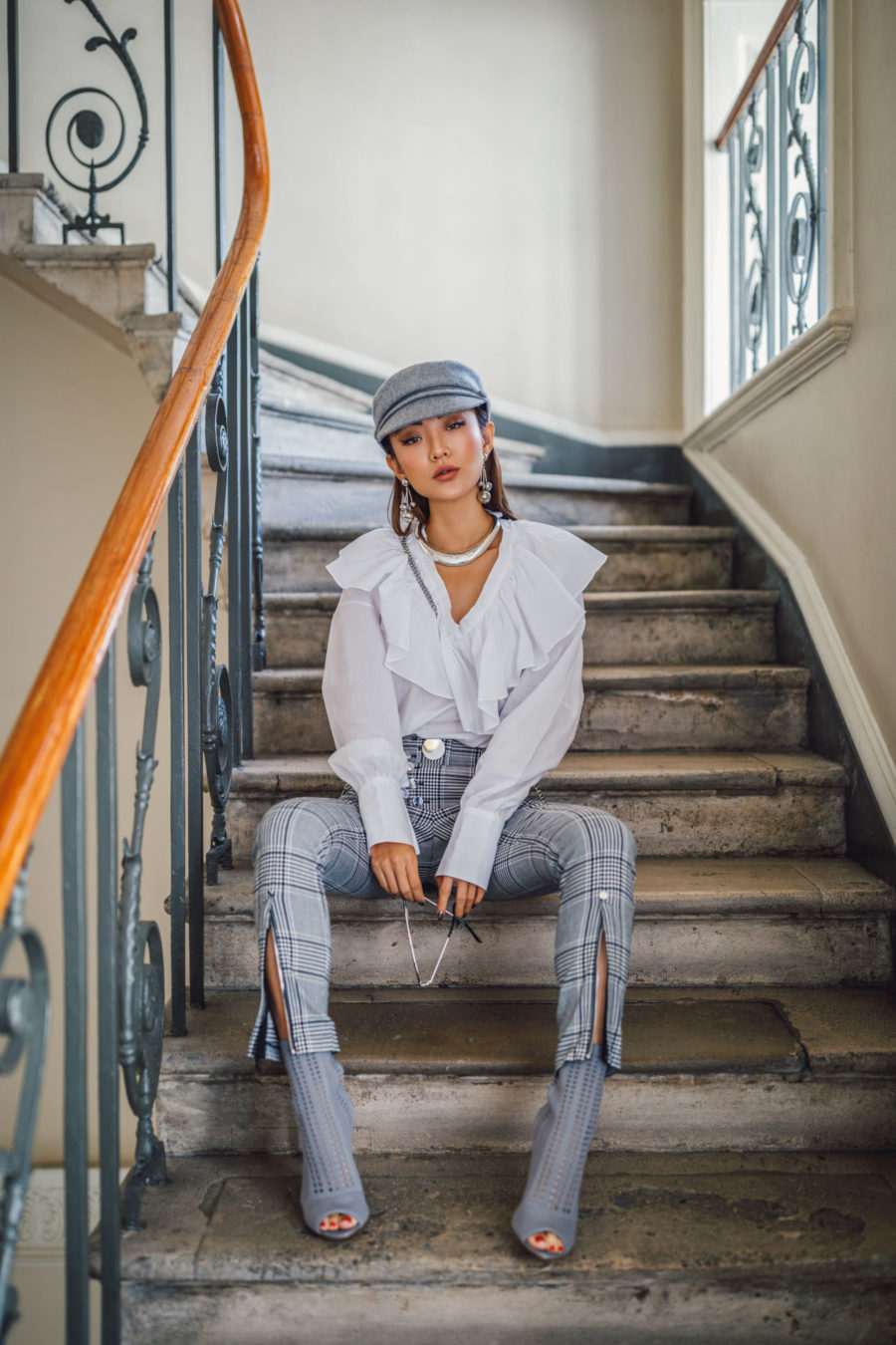 jessica wang wearing a white ruffle shirt, gray plaid pants, and peep toe ankle boots while sharing her favorite out of the box accessories to elevate your outfits // Jessica Wang - Notjessfashion.com