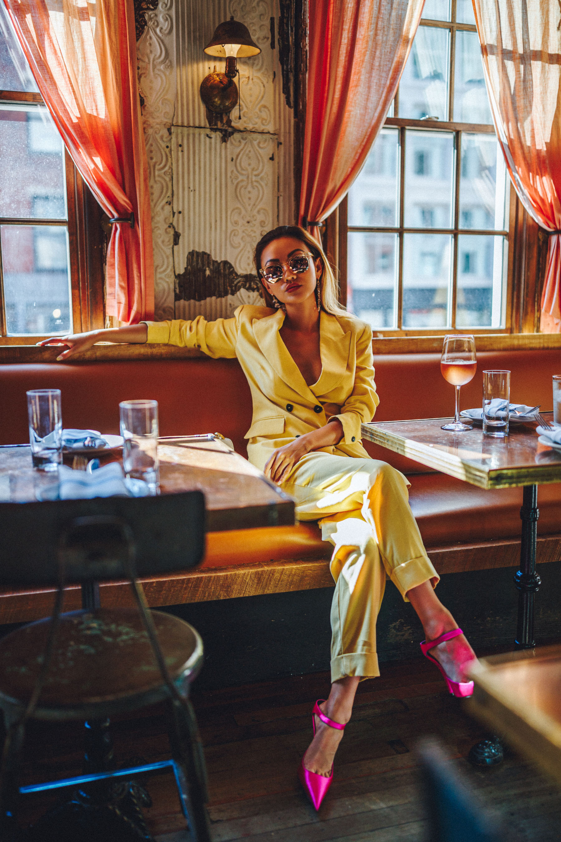 Essential Photography Tips for New Bloggers - yellow suit with pink heels // NotJessFashion.com // jessica wang, new york fashion blogger, asian blogger, fashion blogger street style, street style fashion, monochrome yellow, nyc cafe, round sunglasses, fashion blogger outfit