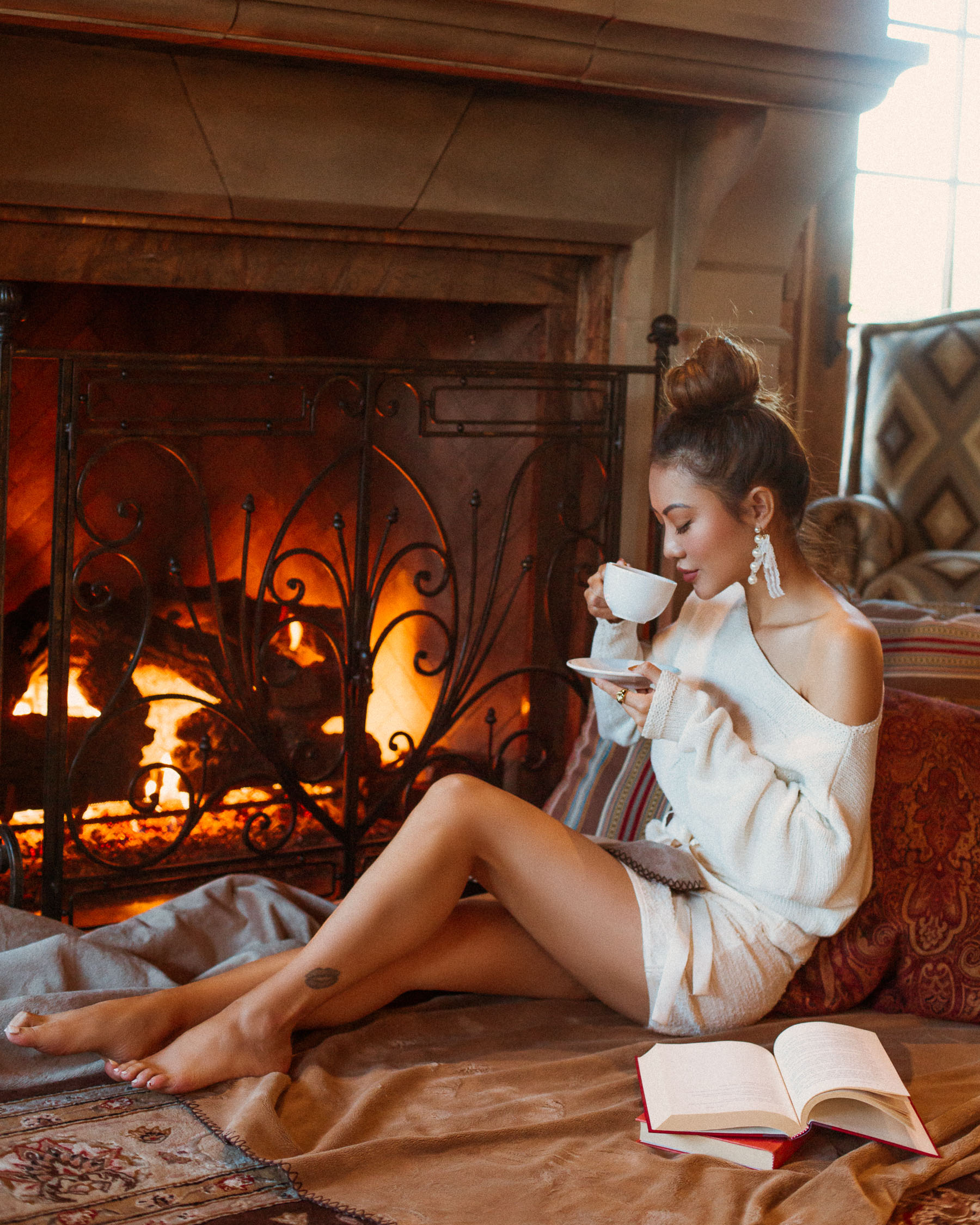 Make more time for yourself in the new year // Cozy white sweater by the fireplace // Notjessfashion.com