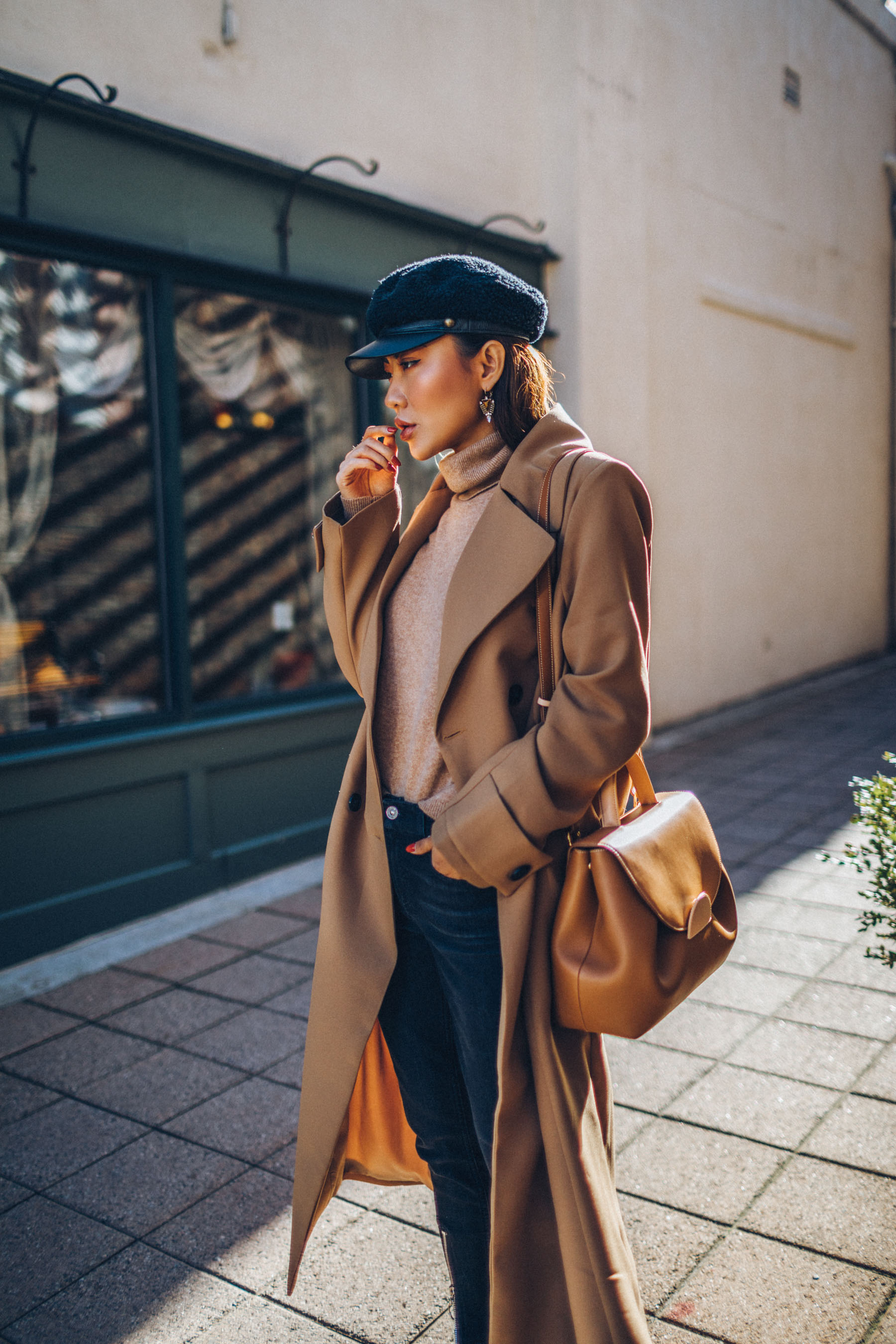 fall workwear essentials, Belted Camel Coat with Dark Denim Baker Boy Cap and Satchel // Notjessfashion.com // New York fashion blogger, asian blogger, classic camel coat, winter outfit, classic winter outfit, cozy layered outfut, nude boots, nude bag, baker boy hat, how to style camel coat, jessica wang, fashion blogger, street style, fashion blogger street style, oversized coat, duster coat, maxi coat
