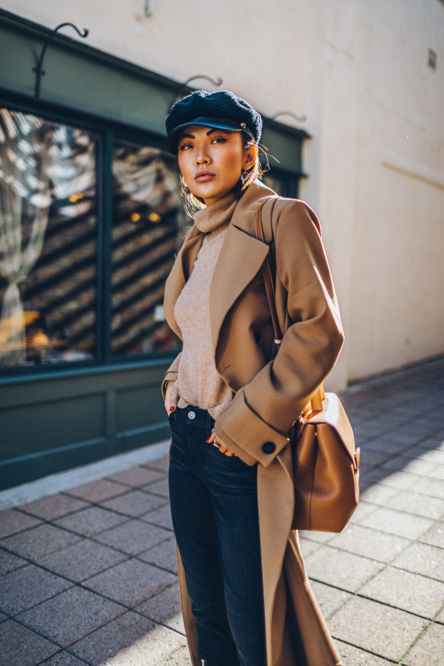 jeans and blazer outfit, baker boy hat, hats for fall, Belted Camel Coat with Dark Denim Baker Boy Cap and Satchel // Notjessfashion.com