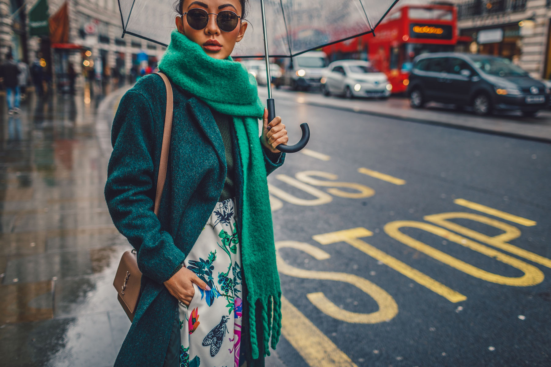 green floral skirt, green coat, dad sneakers, clear umbrella in london // Notjessfashion.com