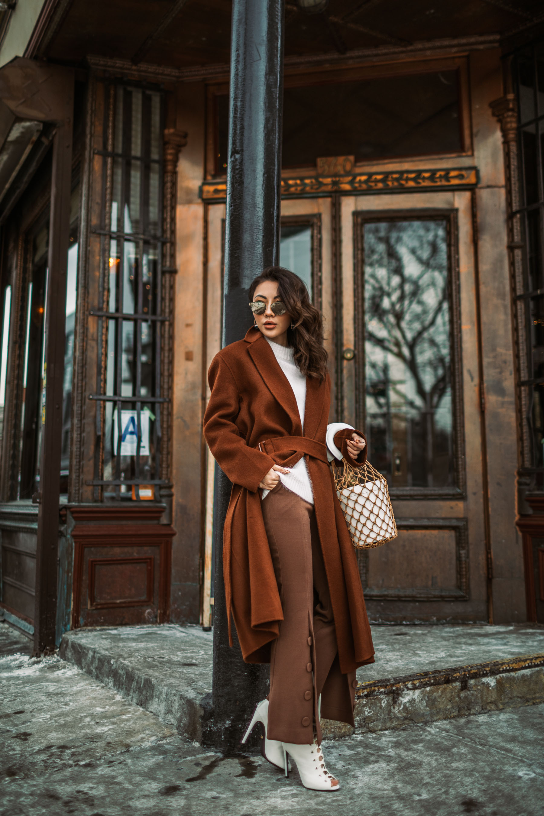Up and Coming Handbag Brands to Know in 2018 // Notjessfashion.com // staud macrame bag, brown button trousers, wrap coat, robe coat, chic winter outfit, new york fashion blogger, aviator sunglasses, brown monochromatic outfit