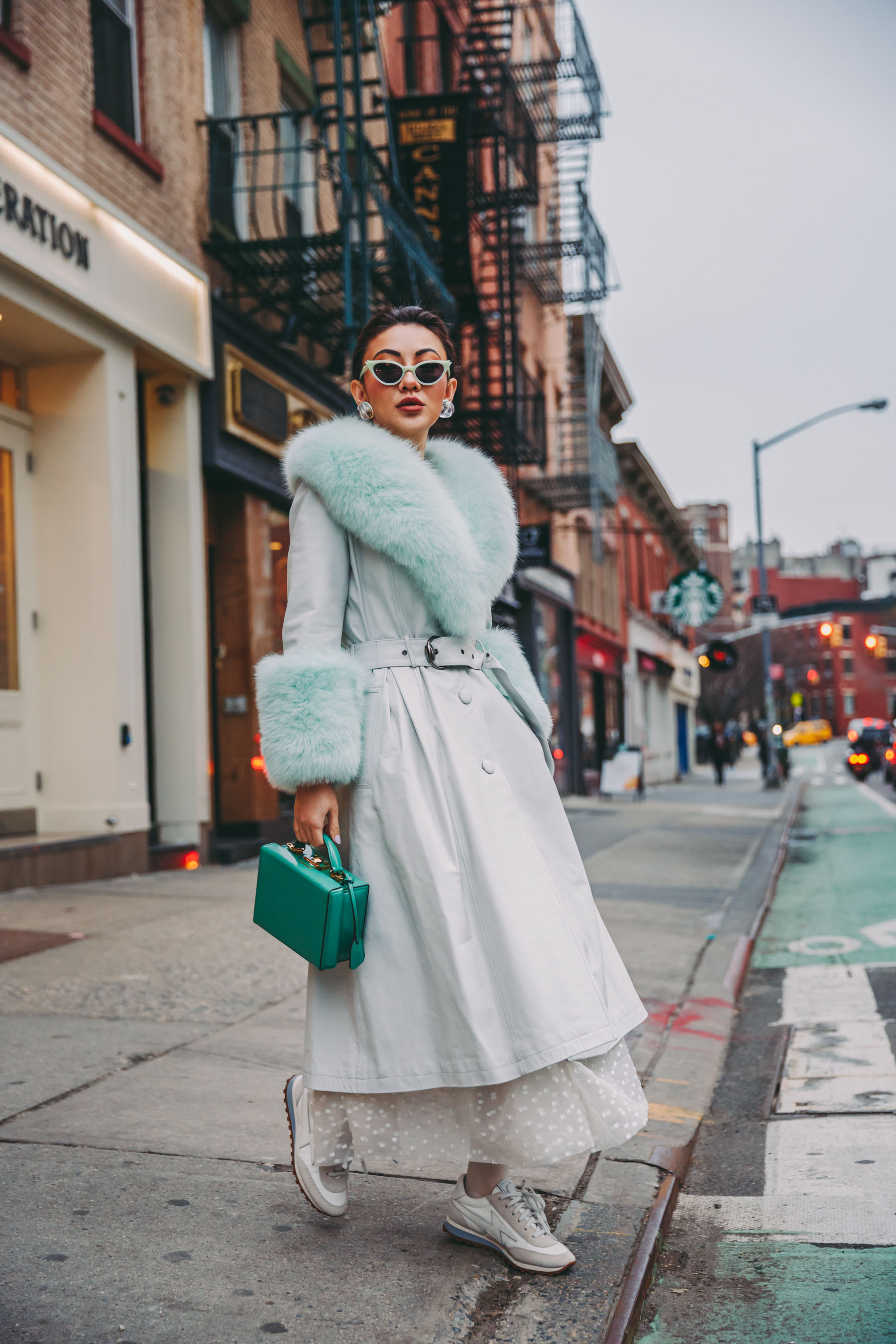 How to Wear Pastel in the winter -Mint fur coat, belted fur coat, nyfw street style // Notjessfashion.com