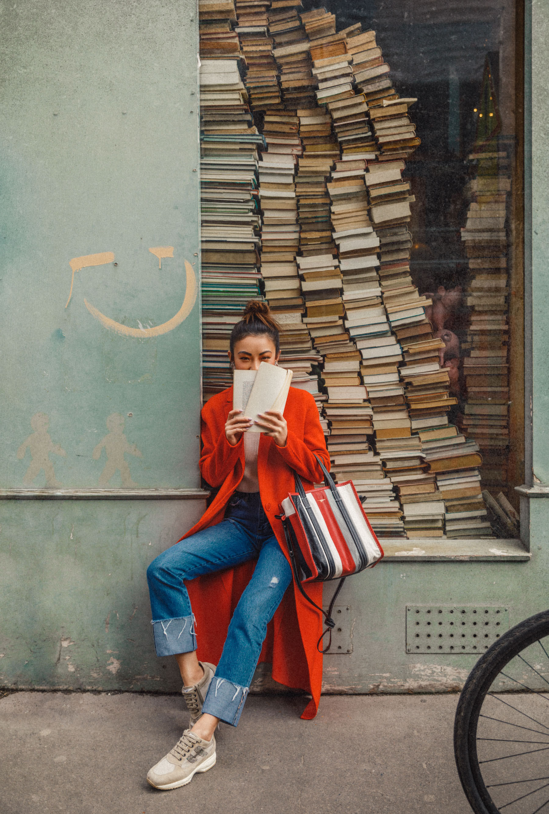 Winter Trends You Can Still Wear In Spring - Bright red coat, cuffed jeans, balenciaga bazar shopper, jessica wang in paris, pfw street style // Notjessfashion.com