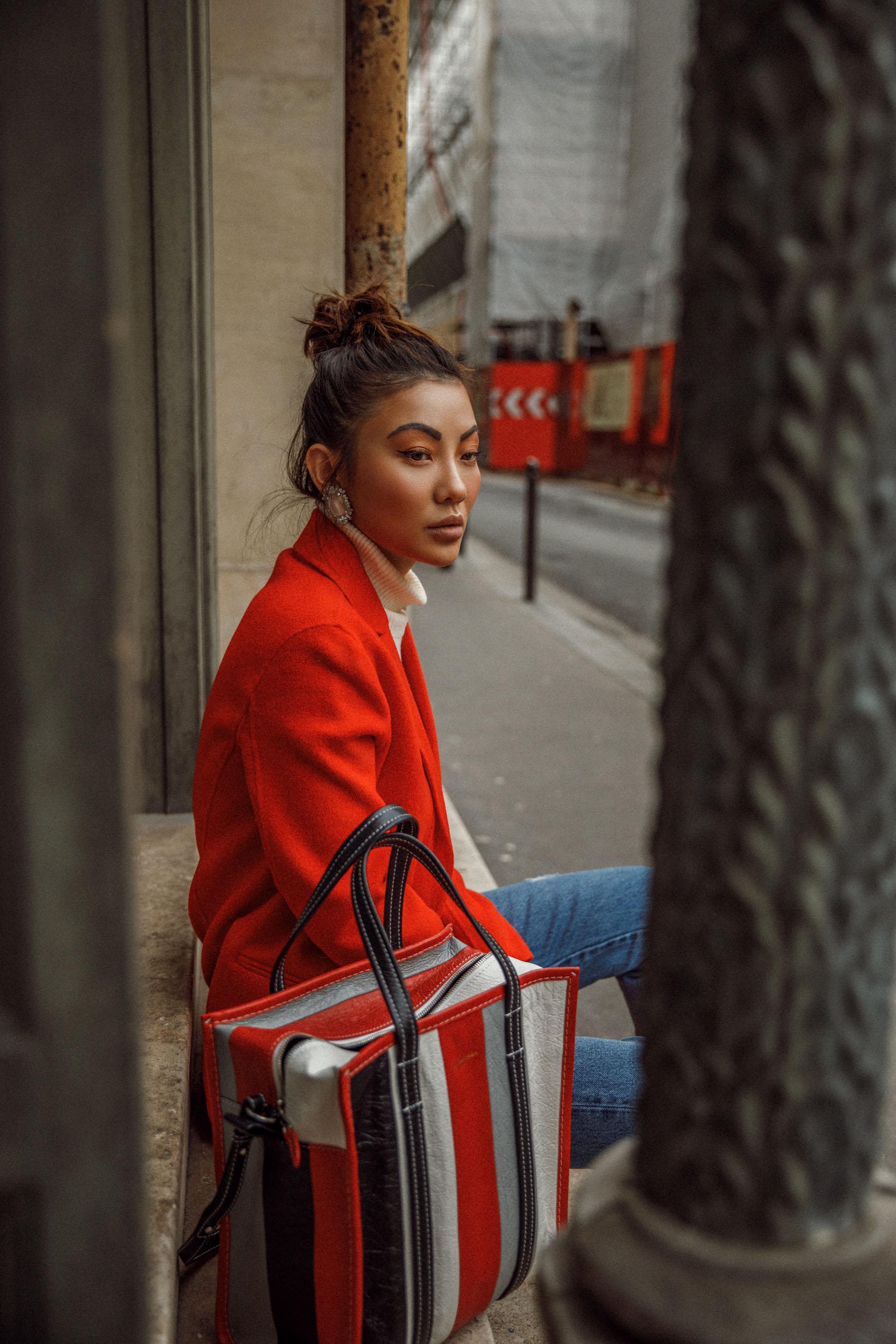 Winter Trends You Can Still Wear In Spring - Bright red coat, cuffed jeans, balenciaga bazar shopper, jessica wang in paris, pfw street style, eiffel tower photo // Notjessfashion.com