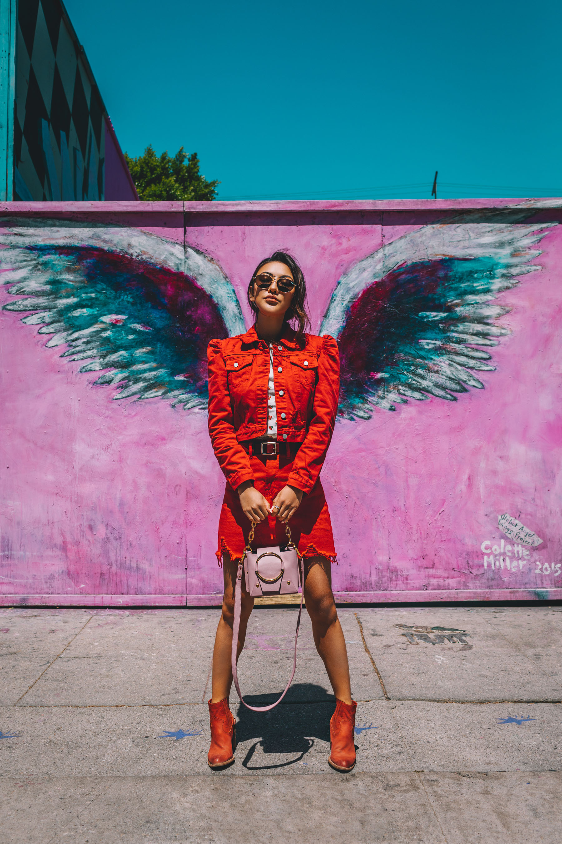 Bold Festival Style - Coachella Outfits Round Up, Red denim oufit, Los Angeles Graffiti Wing Wall // Notjessfashion.com