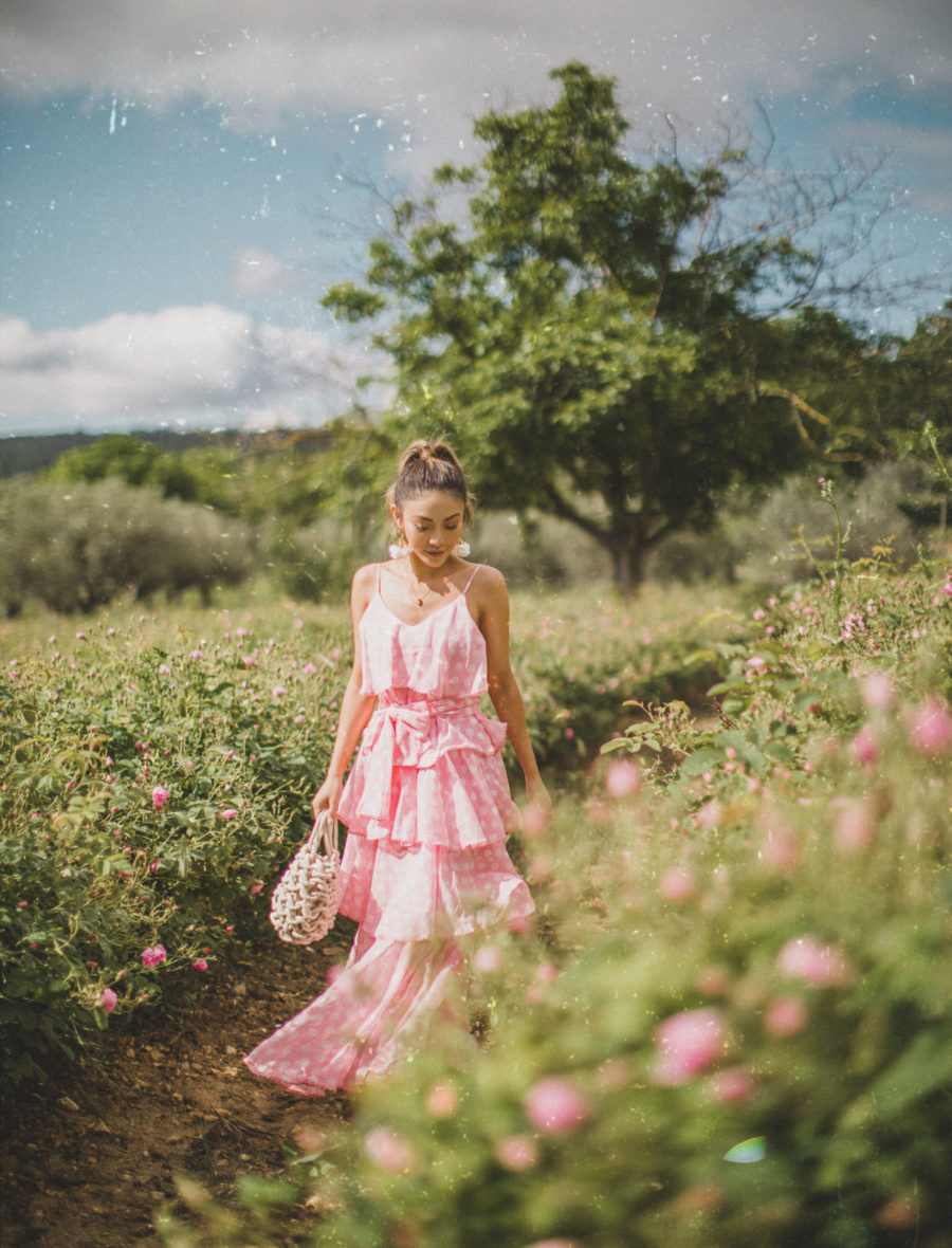Travel in Style - Chic travel outfits, pink sundress, tiered dress, ruffle dress, best summer dresses, summer travel outfits // Notjessfashion.com