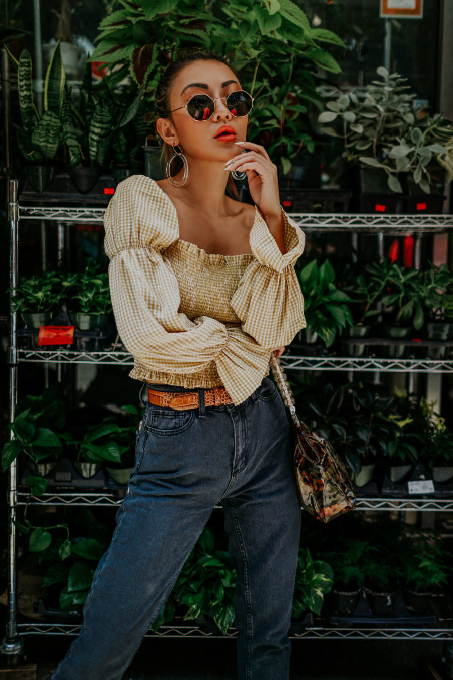 jessica wang wearing BDG Mom Jeans, smocked top, western belt, hexagonal sunglasses while sharing tips on sustainable fashion // Jessica Wang - Notjessfashion.com