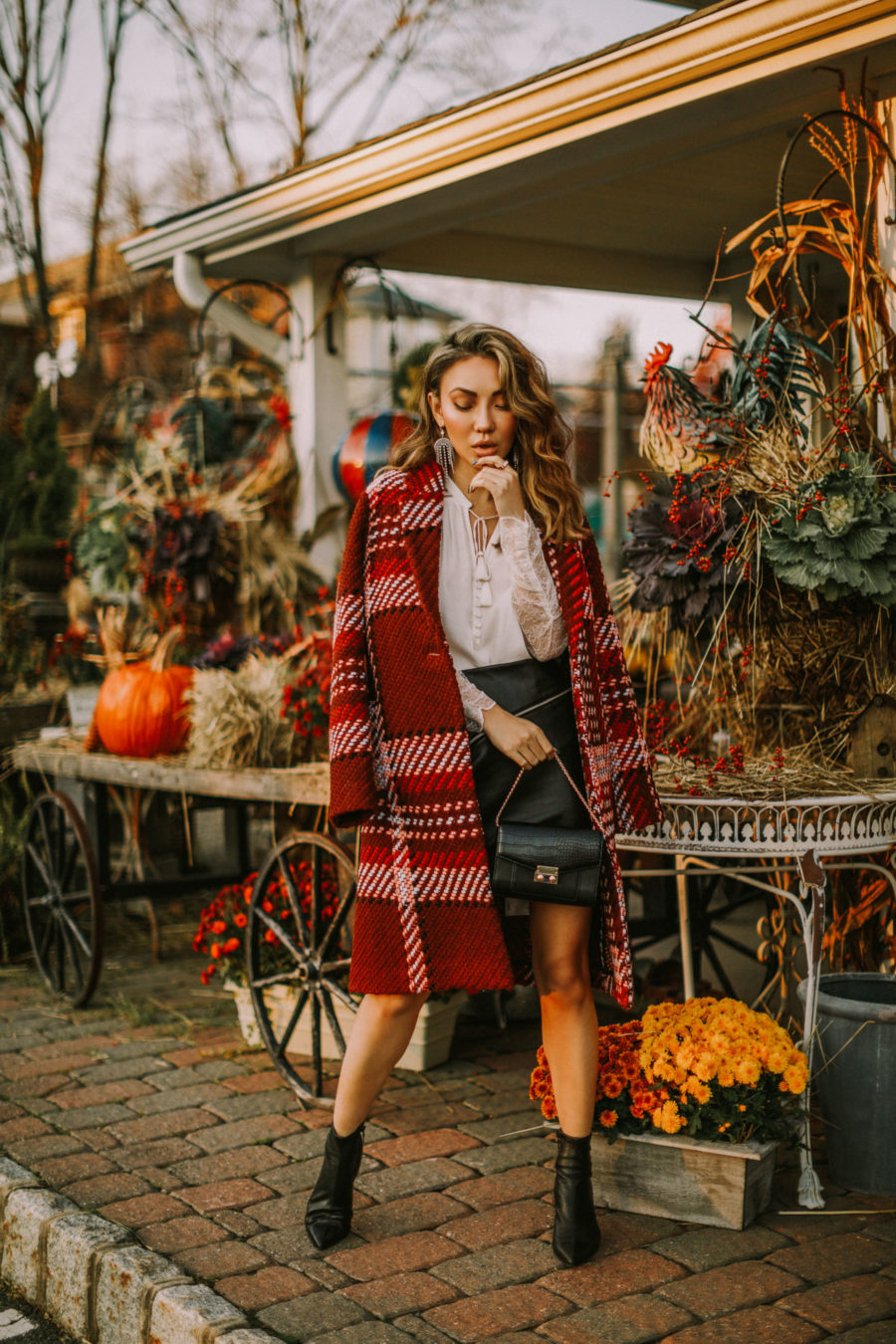 fashion blogger jessica wang shares chic christmas outfits for every day of the week in a plaid express coat and leather mini skirt // Notjessfashion.com