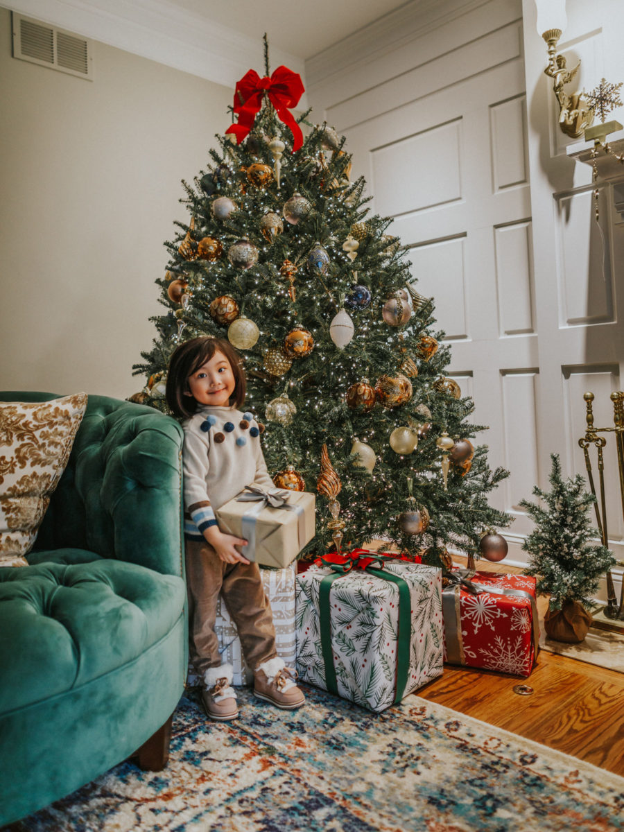 fashion blogger jessica wang's daughter by the christmas tree sharing holiday gifts that give back // Jessica Wang - Notjessfashion.com