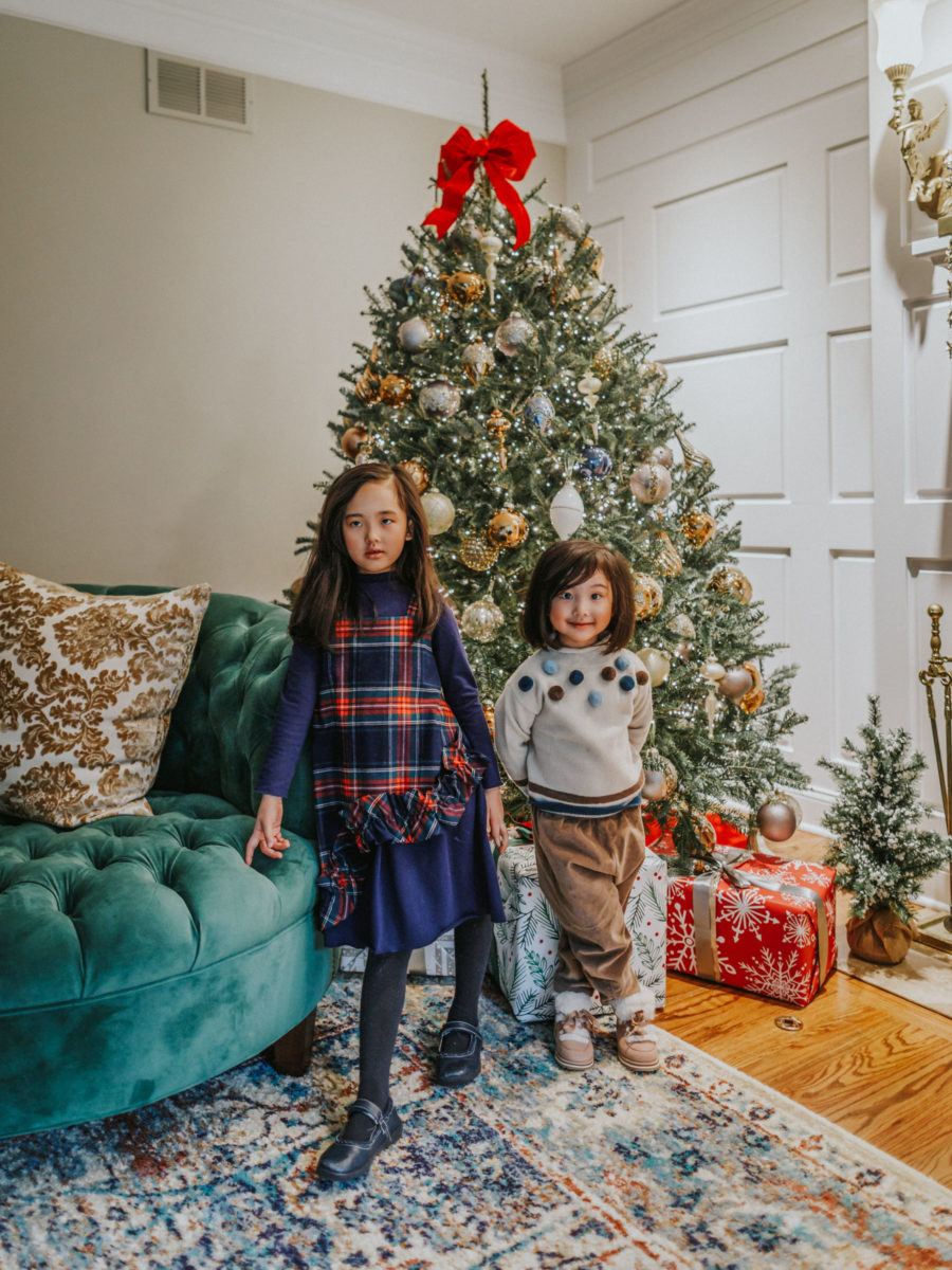 jessica wang's kids sit by christmas tree and shares stocking stuffers for everyone // Jessica Wang - Notjessfashion.com