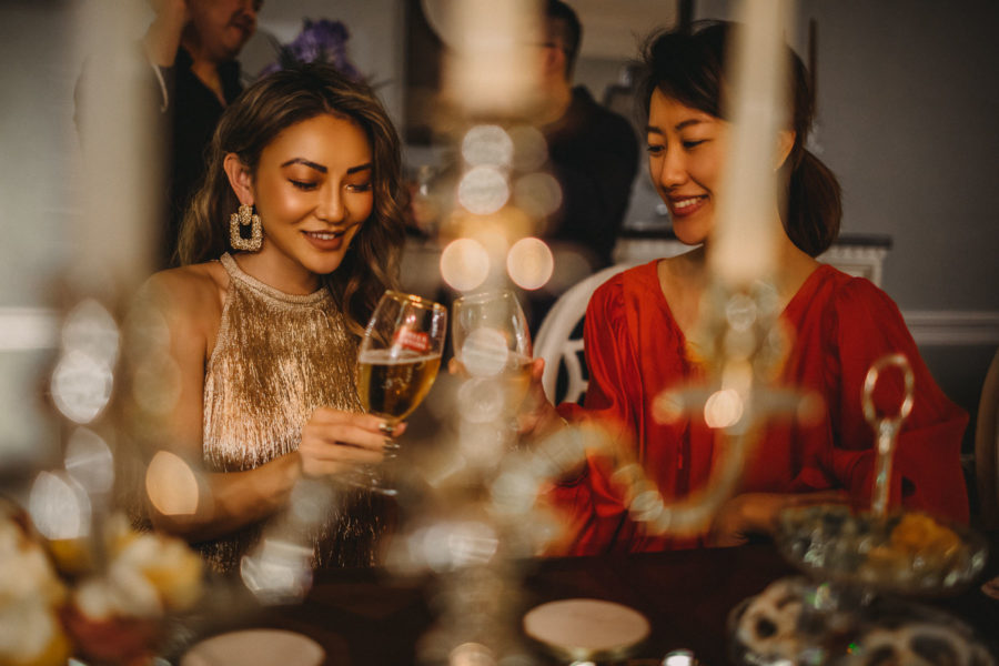 fashion blogger jessica wang throws stella artois party in gold dress