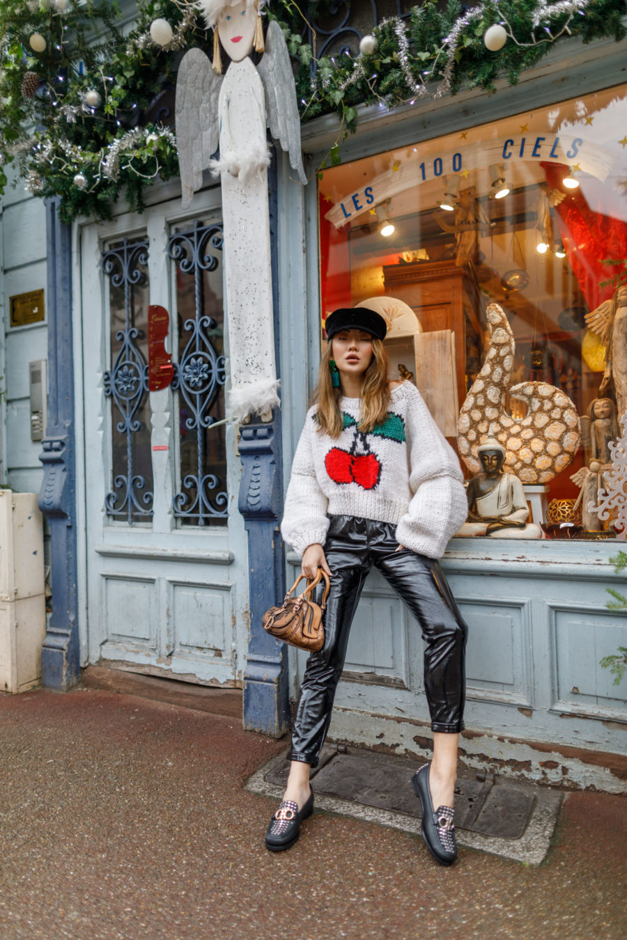 fashion blogger jessica wang shares holiday outfit ideas wearing leather pants and cherry print sweater with studded loafers // Notjessfashion.com
