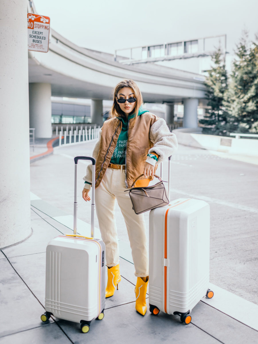 fashion blogger jessica wang wearing white faux shearling coats at the airport // Jessica Wang - Notjessfashion.com