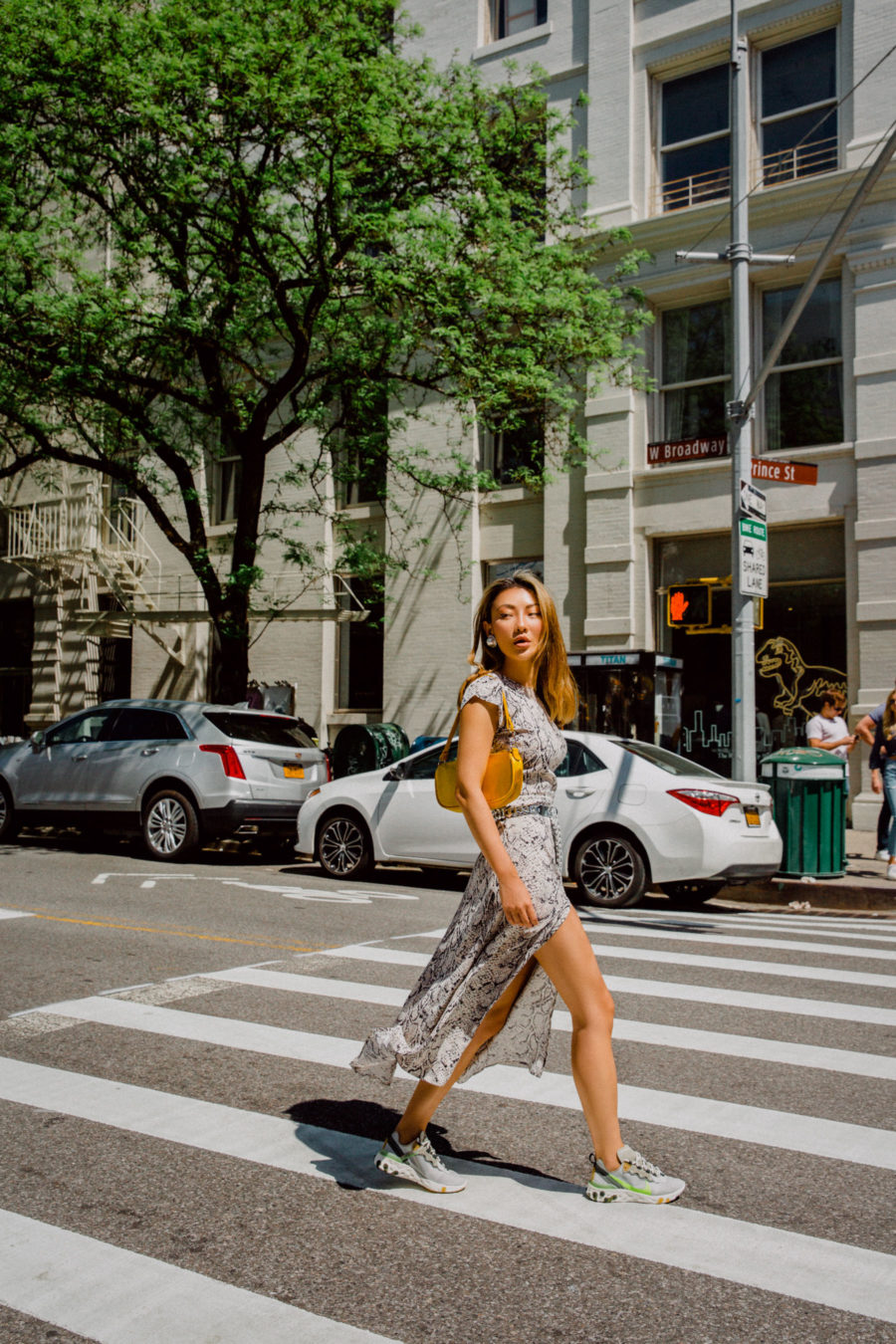 jessica wang vacation outfits with a zebra print dress and nike sneakers // Jessica Wang - Notjessfashion.com