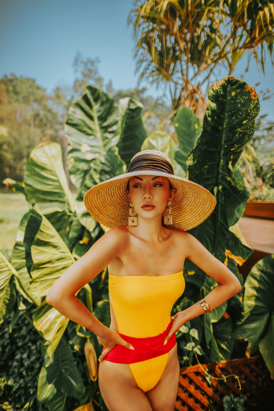 jessica wang wearing a one piece swimsuit and wide brim hat while sharing 2021 swim trends // Jessica Wang - Notjessfashion.com