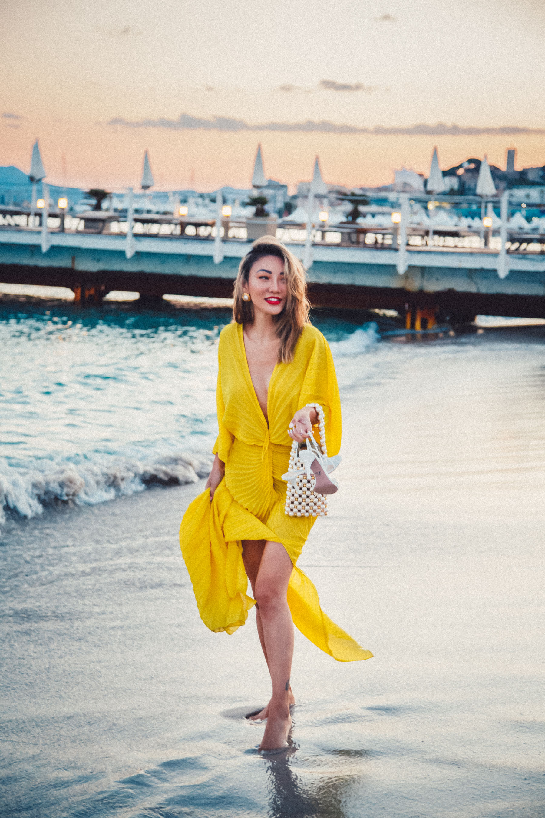 how to wear a dress without a bra, yellow pleated dress, plunging neckline dress // Notjessfashion.com