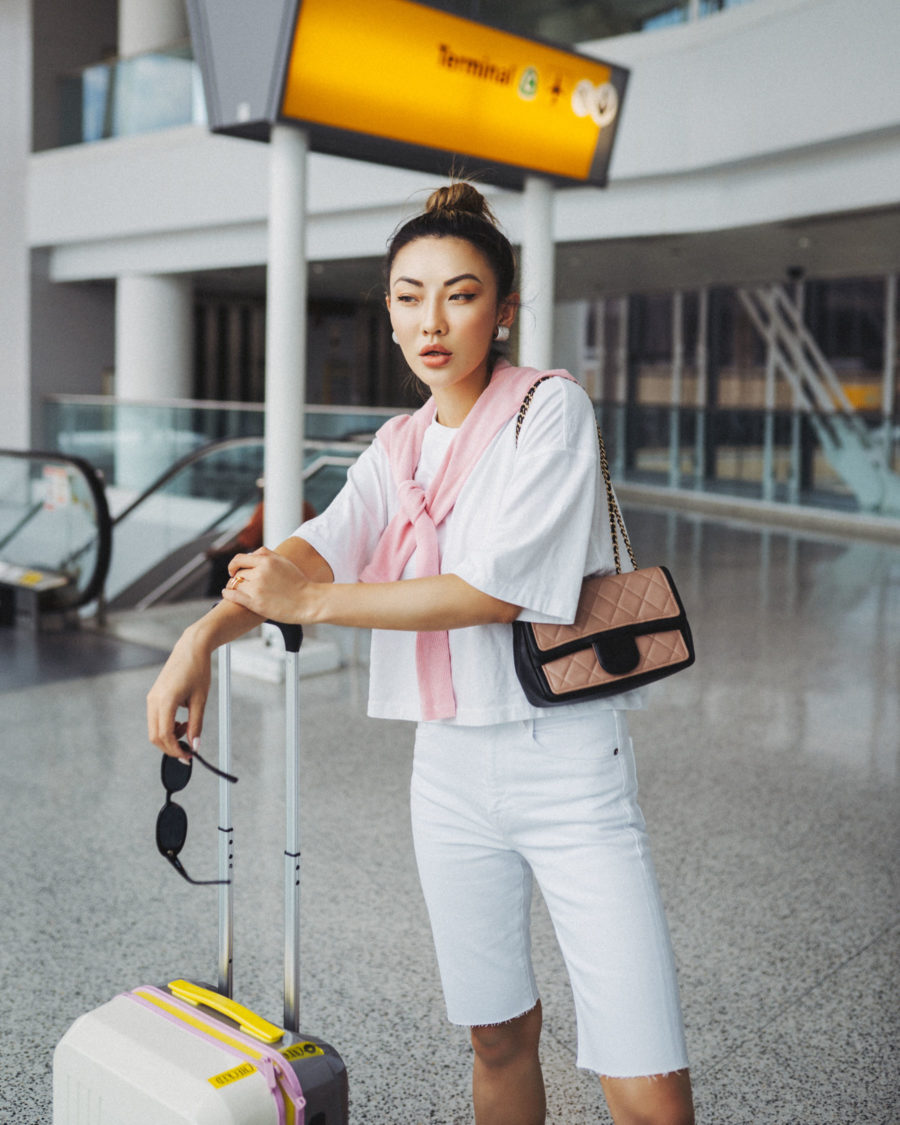 jessica wang wearing an oversized tee with cut off bermuda shorts and miu miu jeweled sandals while sharing her favorite amazon travel essentials // Jessica Wang - Notjessfashion.com