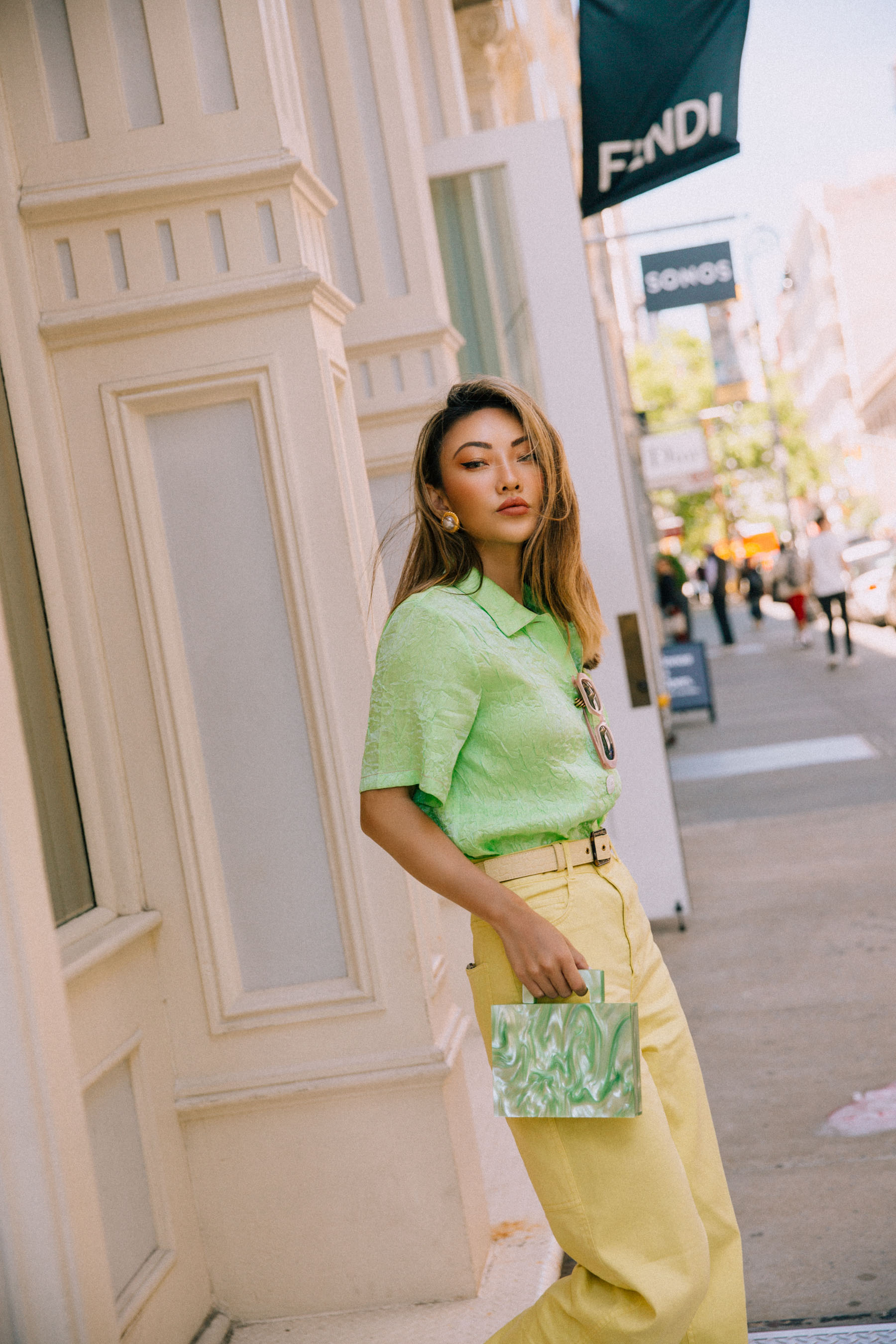 nude belt, sunglasses, Kenneth Jay Lane clip ons - Gold-tone faux pearl clip earrings, rejina pyo crinkle effect satin shirt in green, yellow jeans, How to prepare for a big night out// Notjessfashion.com