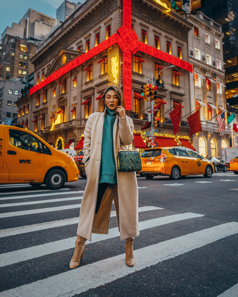 fashion blogger jessica wang wears a green sweater with leggings and boots for the holidays and shares the best gifts for her // Jessica Wang - Notjessfashion.com