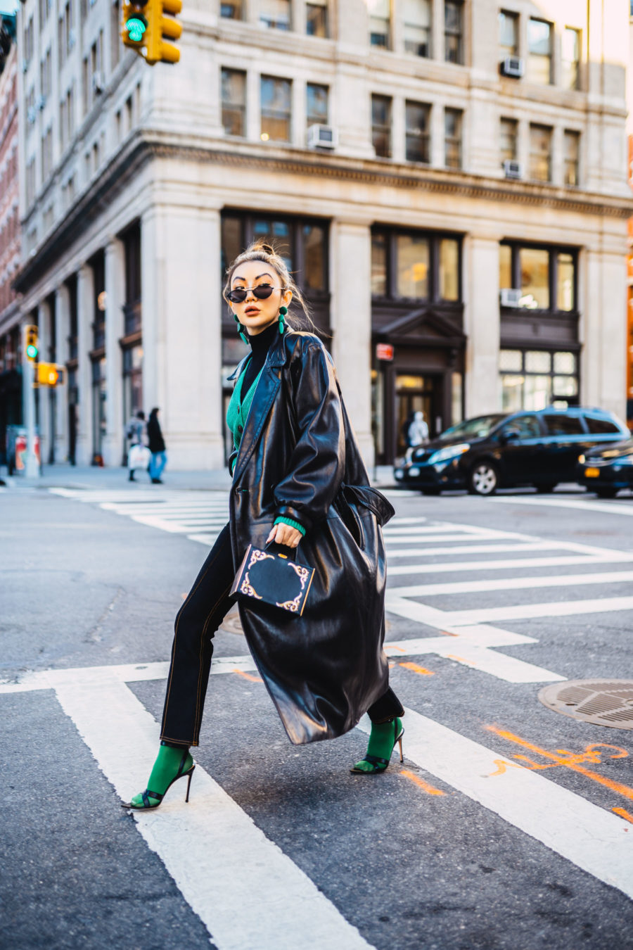 fashion blogger jessica wang shares the best winter coats and wears a leather trench coat with socks and sandals // Notjessfashion.com