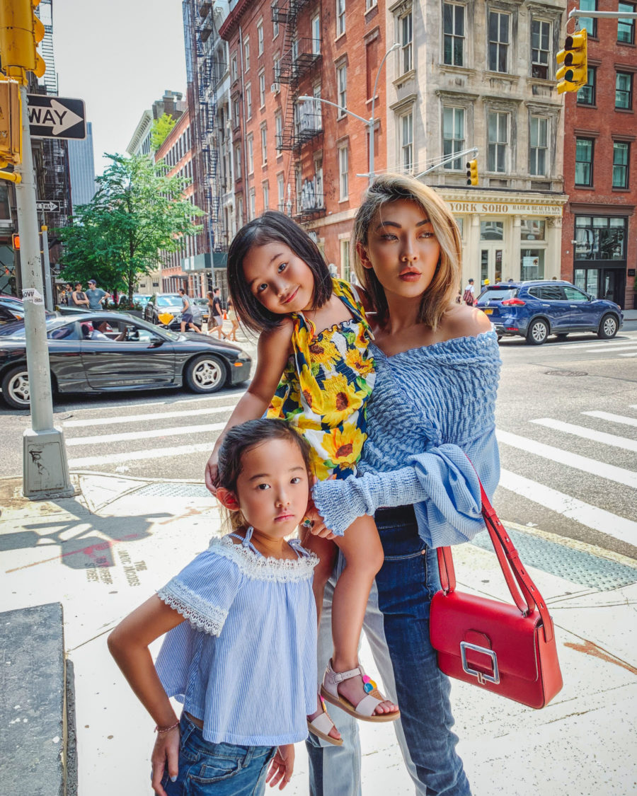 fashion blogger jessica wang spreads awareness on World Children's Day and wears smocked top with two tone jeans with red bally handbag // Notjessfashion.com