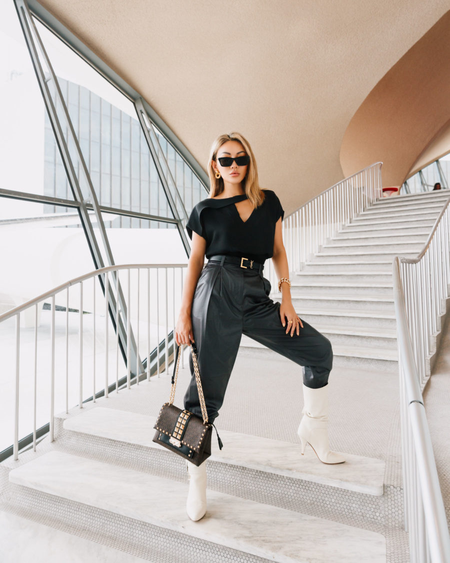 holiday travel looks in leather pants tucked into knee high boots // Notjessfashion.com