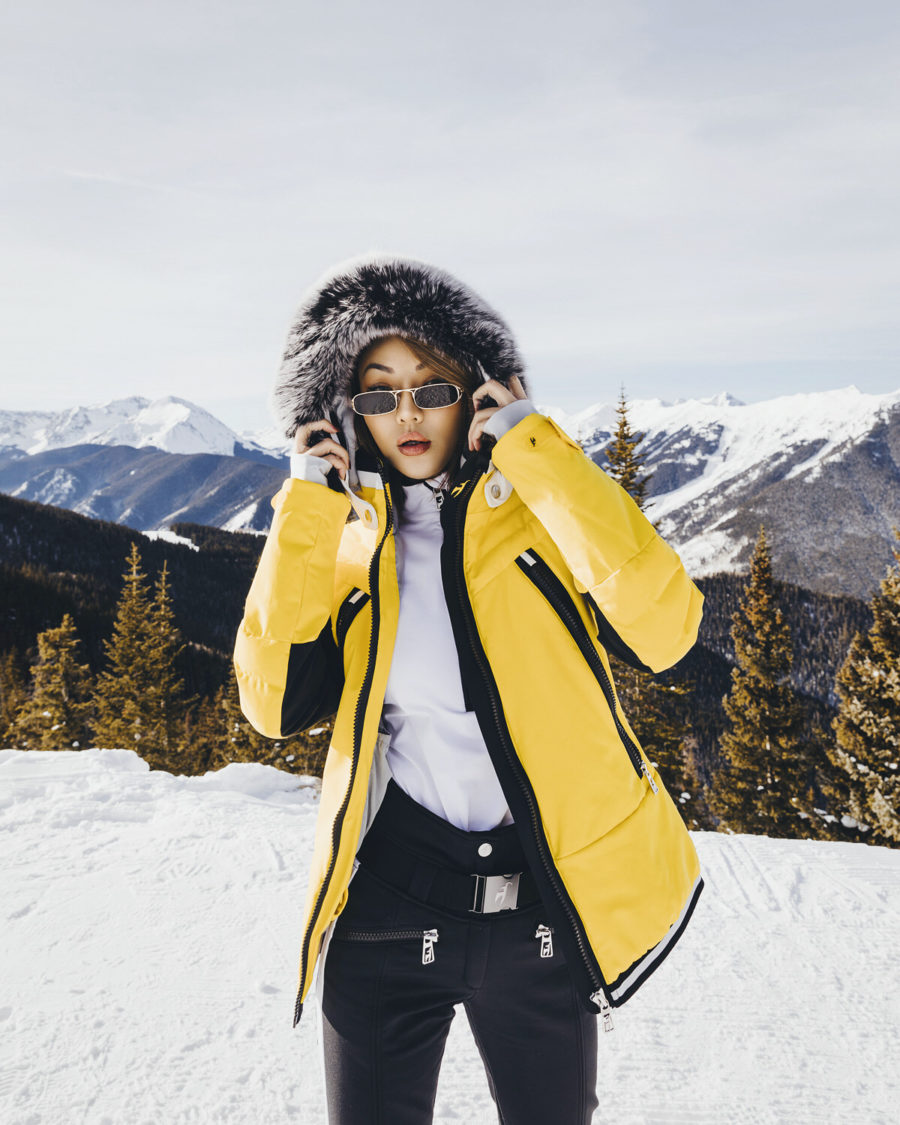 yellow parka on snowy mountain top // Notjessfashion.com