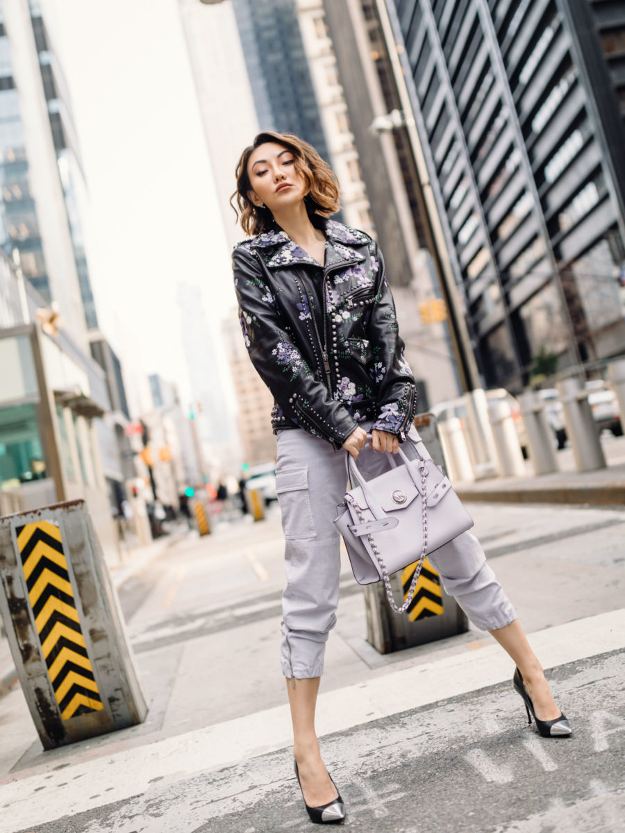 casual cool outfit with michael kors lavender joggers and embellished leather jacket // Jessica Wang - Notjessfashion.com