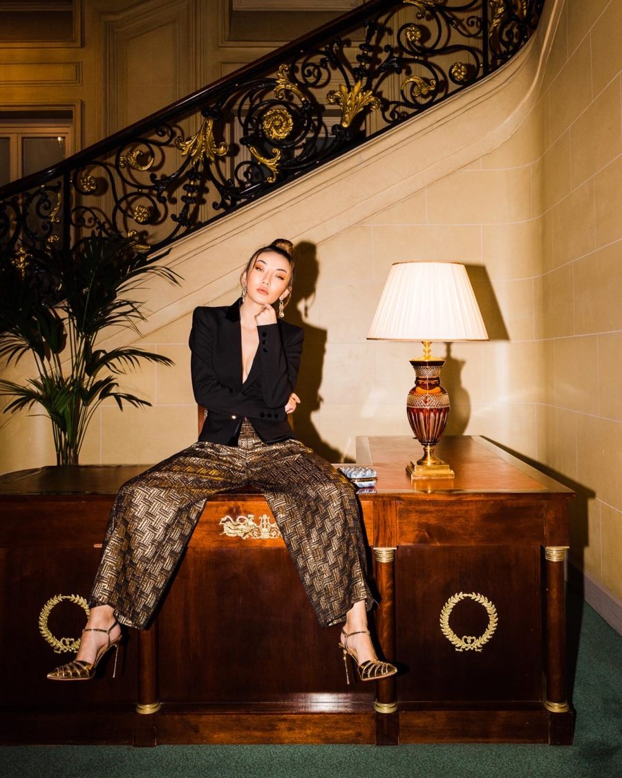 fashion blogger wears gold trousers and a blazer, sharing the must-read books of 2020 // Notjessfashion.com