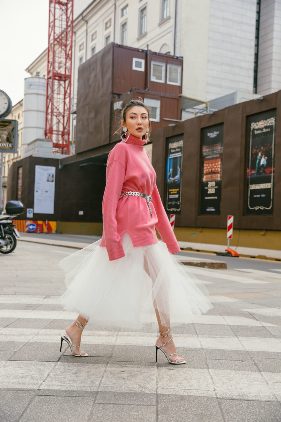 spring trends that are worth the investment featuring loewe coral pink sweater and unravel denim tulle skirt // Notjessfashion.com
