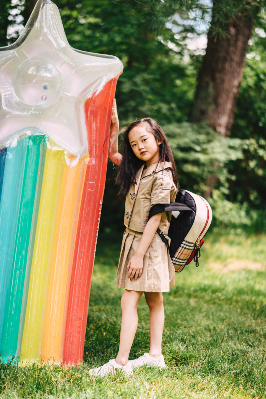 luisaviaroma summer outfits for kids featuring burberry skirt and backpack // Jessica Wang - Notjessfashion.com