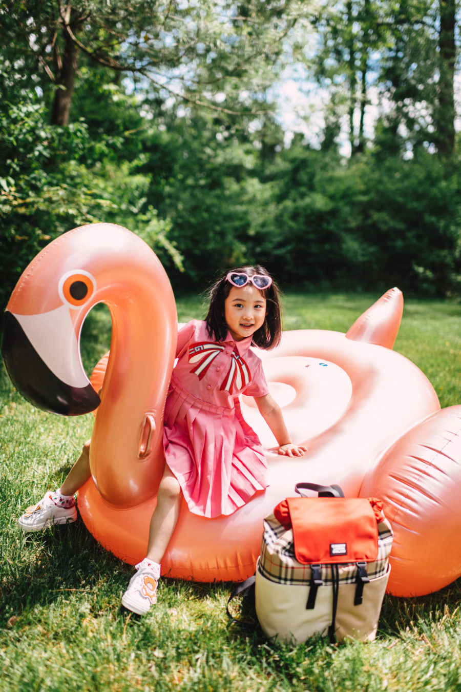 jessica wang's daughter wearing gucci dress on flamingo float // Jessica Wang - Notjessfashion.com