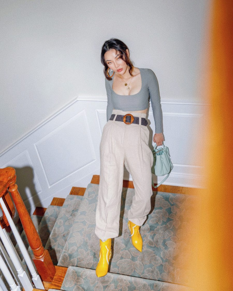 fashion blogger jessica wang at home wearing yellow boots and khaki trousers sharing the best iphone accessories for influencers // Jessica Wang - Notjessfashion.com