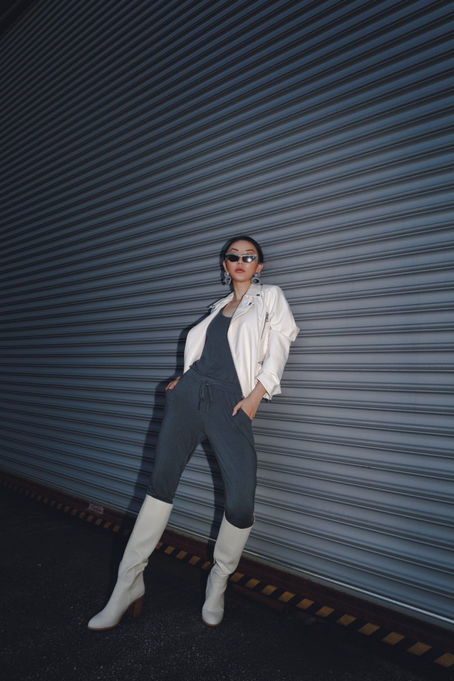 jessica wang wears knit jumpsuit and white leather jacket while sharing ways to transition your summer wardrobe to fall // Jessica Wang - Notjessfashion.com