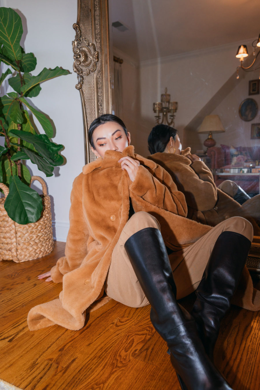 jessica wang wearing a faux fur coat in front of a large gold mirror while sharing trendy decor items for the home // Jessica Wang - Notjessfashion.com