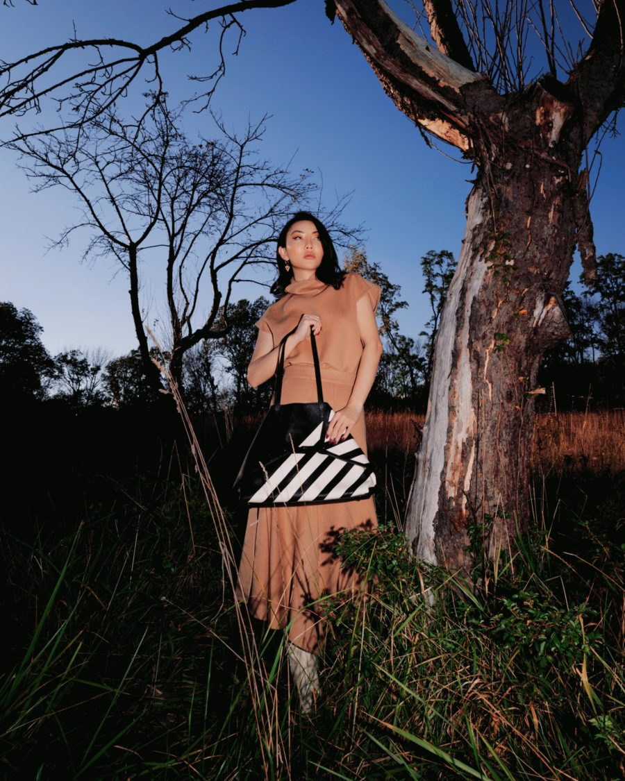 fashion blogger jessica wang wearing a camel outfit with a stripe handbag while sharing photography tips for 2021 // Jessica Wang - Notjessfashion.com