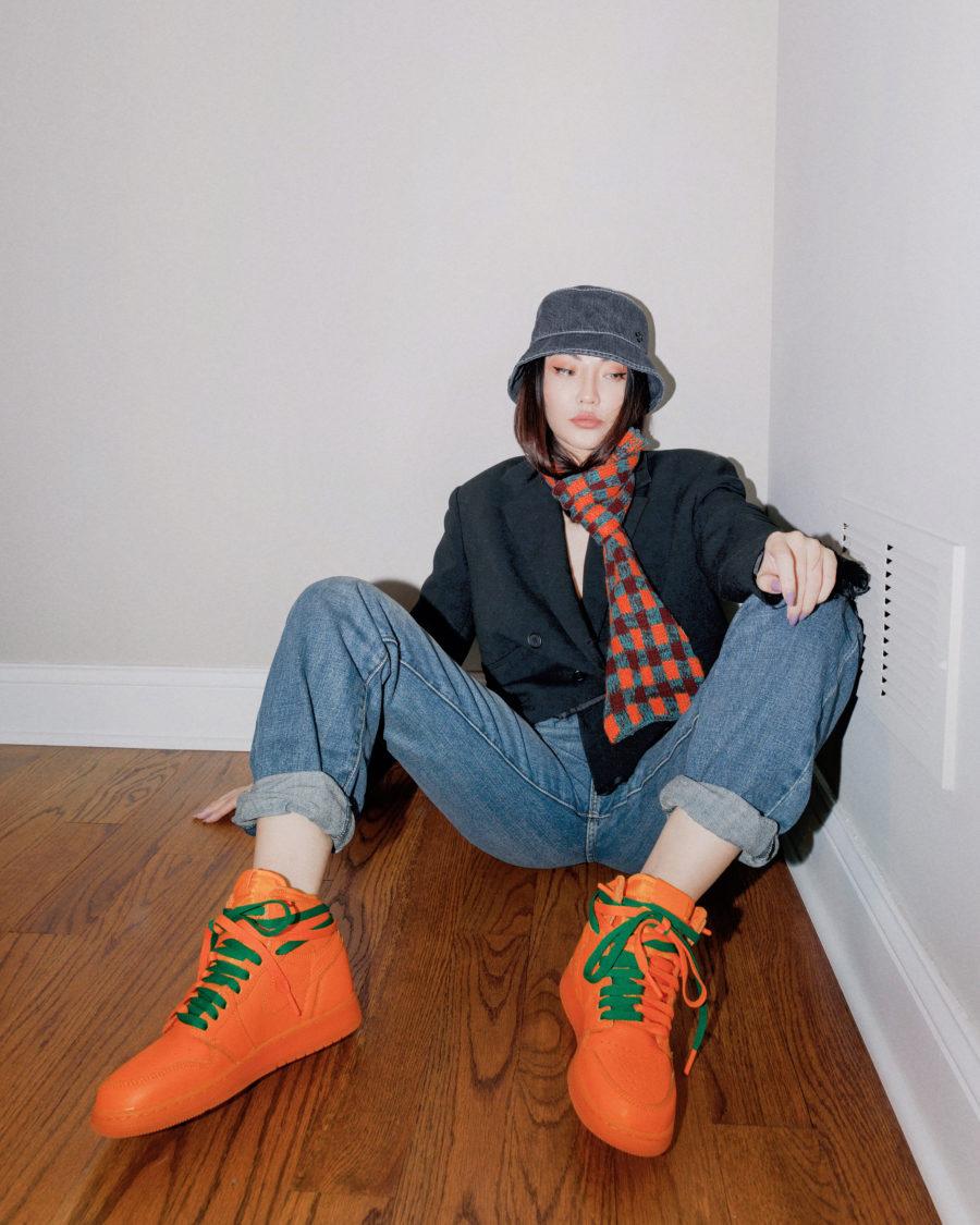 spring 2021 trends - orange nike air force ones, bucket hat, baggy denim, loose denim, black blazer, plaid scarf // Jessica Wang - Notjessfashion.com