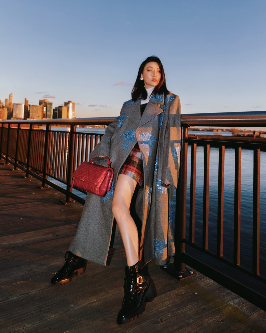 Jessica Wang wearing a longline coat with a plaid skirt and mid calf boots // Jessica Wang - Notjessfashion.com