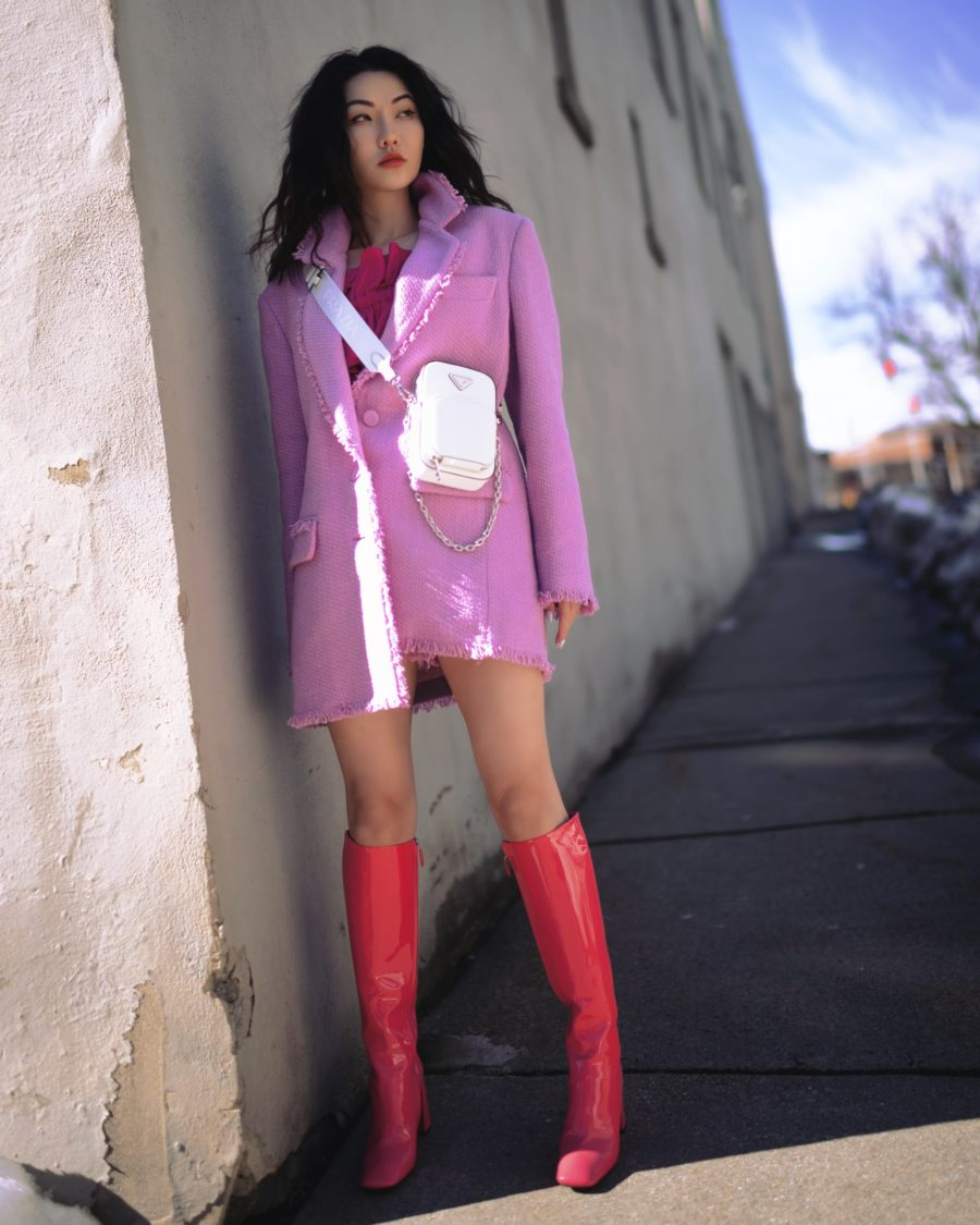 jessica wang wearing a MSGM Fringe blazer and shorts with pradra patent boots, and a prada mini bag while sharing casual spring suits for women // Jessica Wang - Notjessfashion.com