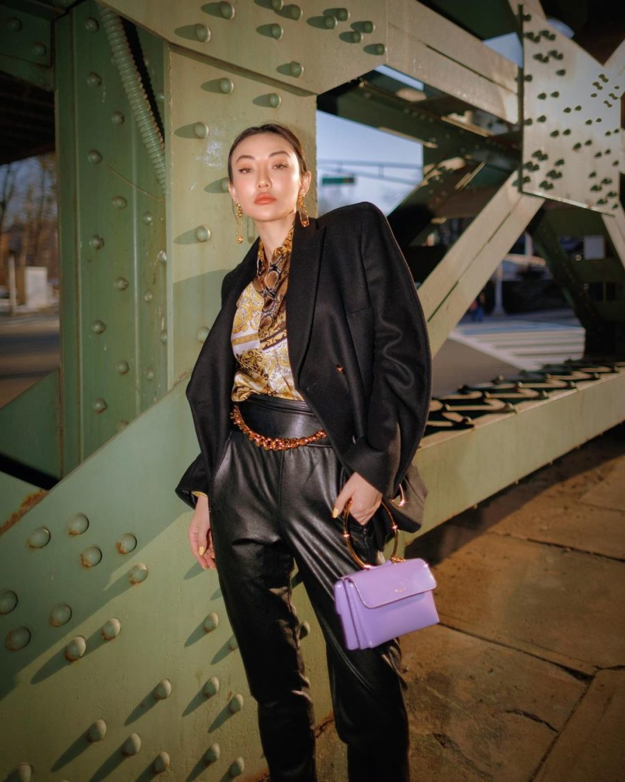 jessica wang wearing a black blazer with leather pants, a chain belt, and holding a lavender handbag while sharing spring accessories to wear for 2021, pastel handbags// Jessica Wang - Notjessfashion.com