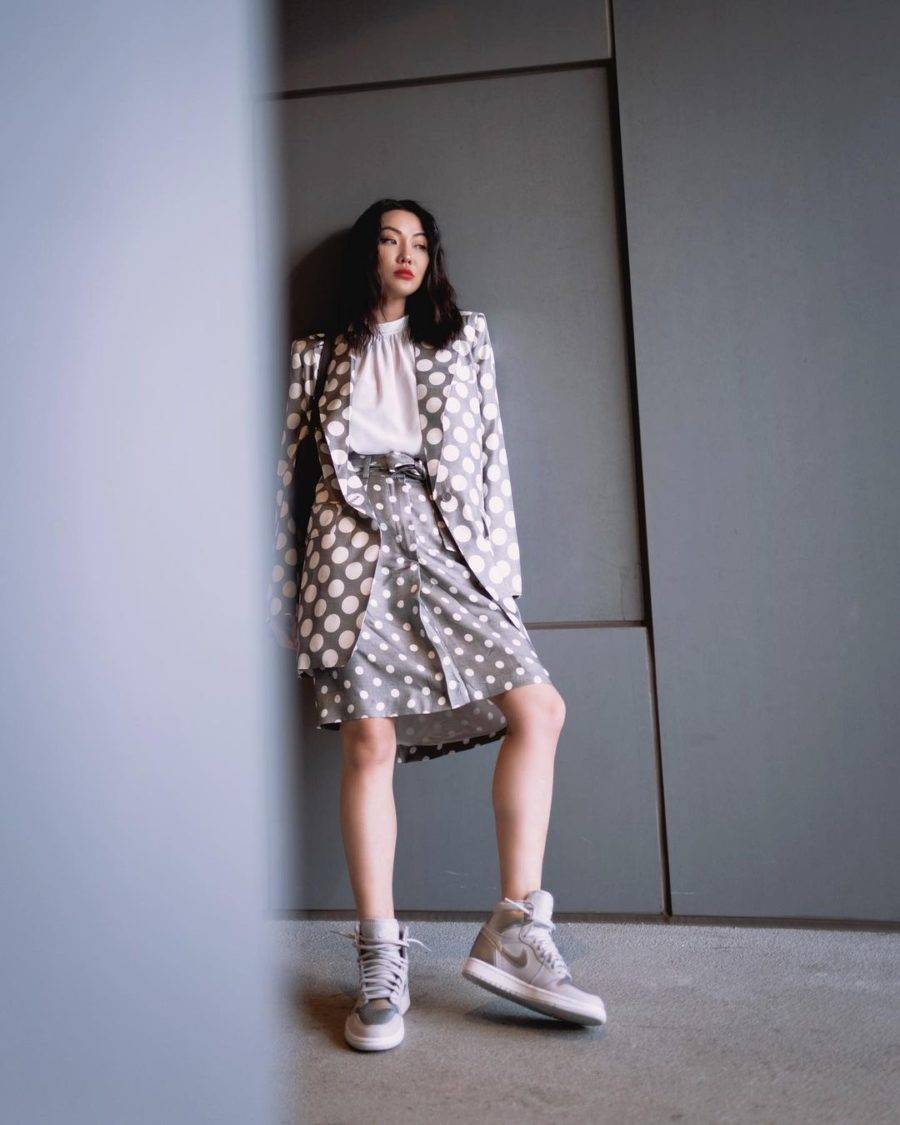 jessica wang wearing a matching polka dot blazer and skirt with air jordan sneakers while sharing what spring accessories to wear for 2021, high top sneakers // Jessica Wang - Notjessfashion.com