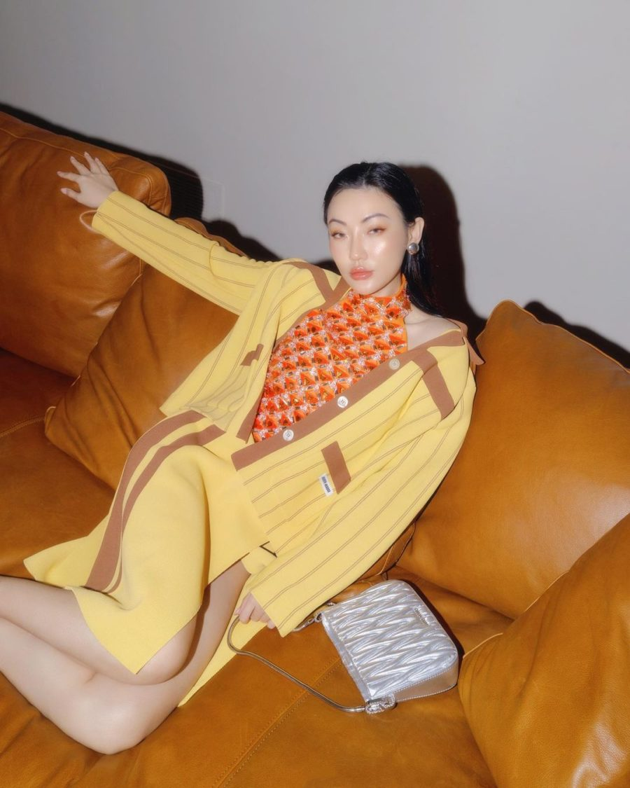 jessica wang wearing a yellow sweater with a matching skirt and holding a silver miu miu purse while sharing trendy handbags for summer // Jessica Wang - Notjessfashion.com