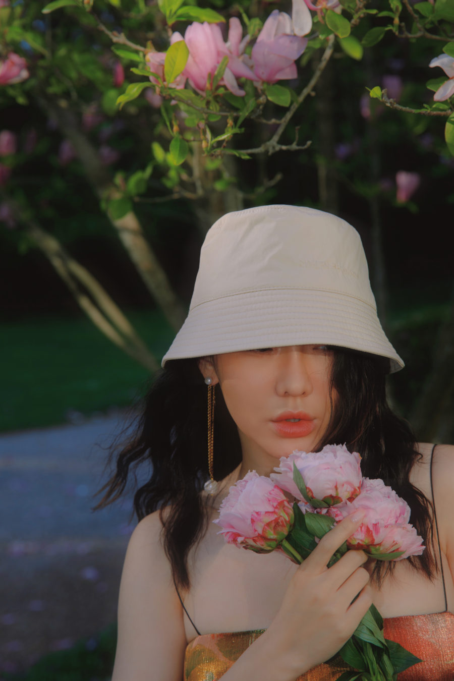 jessica wang wearing a bucket hat and flowers while sharing last minute mother's day gifts at luisaviaroma // Jessica Wang - Notjessfashion.com