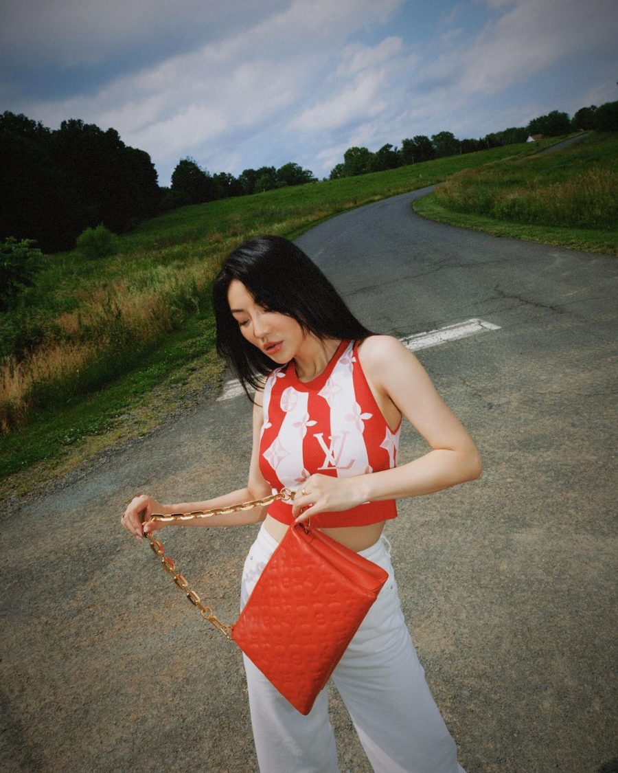 jessica wang wearing a louis vuitton stripe sweater vest with a red louis vuitton handbag while sharing the best labor day sales 2021 // Jessica Wang - Notjessfashion.com