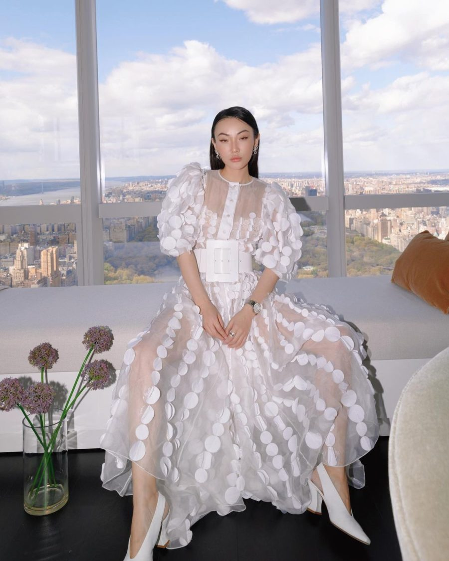 jessica wang wearing a white sheer dress and a wide white belt while sharing her favorite out of the box accessories to elevate your outfits // Jessica Wang - Notjessfashion.com